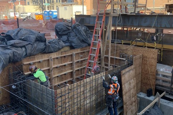 Iron workers working below ground setting up frames and rebar