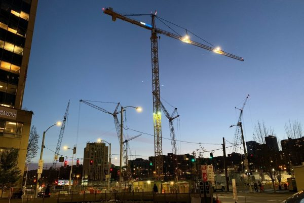Dawn street level view of Washington State Convention Center addition job site and cranes